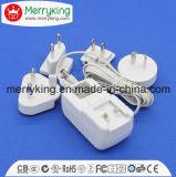 Spannungs-Adapter Wechselstrom-12V1.5A mit austauschbaren Wechselstrom-Steckern