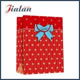 Смычок тесемки красных многоточий изготовленный на заказ продает бумажную хозяйственную сумку оптом одежд