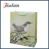 きらめきの鳥のアイボリーペーパー手のショッピングギフト袋とカスタマイズしなさい