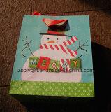 Sac à provisions de papier, sac de papier estampé par logo fait sur commande de Noël