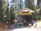 أسرة يخيّم سقف خيمة علبيّة