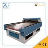 TM1610ファッション産業の倍ヘッドファブリック綿布の革カッターの価格のための自動挿入の織物レーザーの打抜き機