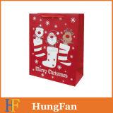 型抜きされたハンドルが付いている方法クリスマスのショッピングペーパーギフト袋