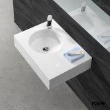 白い石造りの樹脂の固体表面の浴室の虚栄心の洗面器