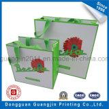 Sacchetto di acquisto di carta stampato di lusso di colore rosso con il marchio dorato