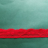 Il merletto floreale rosso della guarnizione del reticolo di Brigh con le frange comercia