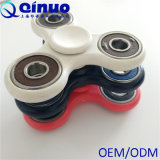 O tri redutor do esforço do brinquedo da mão da inquietação do girador 3 minutos alisa a rotação para miúdos