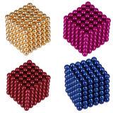 Esferas magnéticas cor-de-rosa roxas da cor vermelha