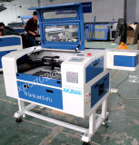 Mini laser Cutting e Engraving Machine di CNC CO2 di Akj6040 Plywood per Craft Low Price