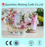 La main a ouvré les figurines intéressantes de fée de fleur de décoration de maison de résine