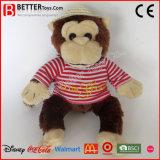 布および帽子の詰められたおもちゃ猿をカスタマイズしなさい