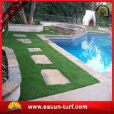 Abbellimento del tappeto erboso artificiale sintetico poco costoso dell'erba per la decorazione del giardino