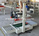 Fxj9050tの狭く高いカートンボックスシーリング機械装置