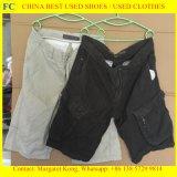 Les hommes de balle court- le vêtement utilisé par vente en gros d'été de T-shirt de collier de chemise