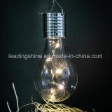 Weißes kupferner Draht-feenhaftes Solarlicht mit der Edison-Luftblase, die in der Garten-Weihnachtsdekoration hängt