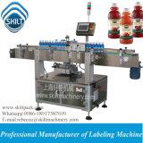 Una máquina de etiquetado lateral de la botella de la etiqueta engomada para la botella del jugo