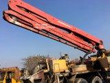 Pompe à béton usée Putzmeister à distance de 37 m avec camion (45m / 46m)