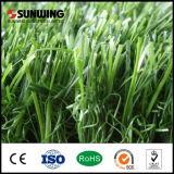 Tapete ao ar livre do relvado sintético que ajardina a grama artificial