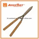 Las tijeras de podar de la herramienta de jardín forjaron esquileos del seto con las manetas de madera