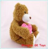 Cadeau de Valentine avec l'ours de nounours rouge de peluche de coeur