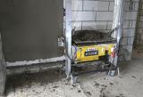 Rappresentazione concreta della migliore parete che intonaca la macchina del miscelatore