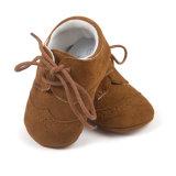男の子および女の子の滑り止めの最初歩行者、柔らかい足底PUの革赤ん坊靴
