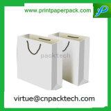 Bolso de compras modificado para requisitos particulares blanco simple del papel de Kraft con la impresión de la insignia