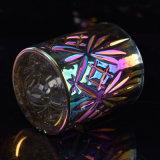Ion que platea los tarros de cristal de la vela del color brillante
