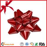 金属星はクリスマスのギフト用の箱のためのリボンを曲げる