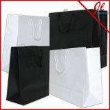 着色された光沢のある白いショッピング・バッグのクラフトのショッピング紙袋