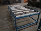 Machine de formage de panneaux de toit en acier
