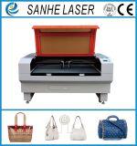 Découpage de machine de gravure de graveur de laser de CO2 de cuir de tissu d'alimentation automatique avec 100W130W