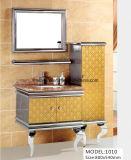 Assoalho que está o gabinete da vaidade do banheiro do aço inoxidável