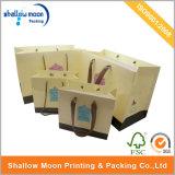 絹のリボンおよびハンドルの黄色いショッピング紙袋(QY150275)