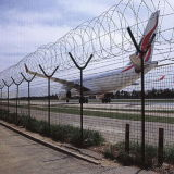 Пластичная верхняя часть загородки службы безопасности аэропорта с катушкой провода бритвы
