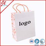 Sac bleu de cadeau de papier d'emballage de sacs de modèle d'Eco de fleur avec le traitement de torsion ou le traitement plat