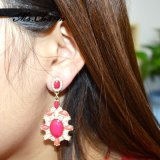 女性金カラーぶら下がるイヤリングのための贅沢によって満たされるピンクのアクリルのラインストーンの低下イヤリング