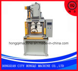 Machine de moulage injection verticale
