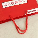 ハンドルのショッピング・バッグの緑および環境袋が付いている紙袋