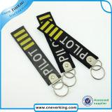 Choisir le trousseau de clés de tissu de broderie de logo, le retirer avant la chaîne principale de vol