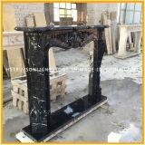 Camino di marmo nero della mensola del camino della pietra del posto del fuoco di Marquina con la mano intagliata