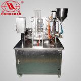 Tazas plásticas automáticas rotatorias que llenan la crema de la máquina del lacre