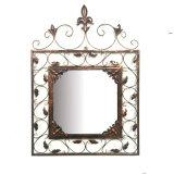 La decorazione antica di arte della parete del metallo lascia lo specchio
