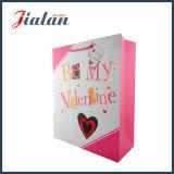 Le jour fait sur commande Womans du `S de Valentine estampé par logo jaune portent le sac de papier