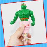 El plástico embroma el juguete con el caramelo duro del Jellybean dulce