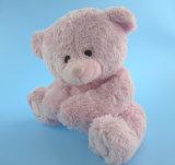 Urso urso de pelúcia sentado com urso em rosa