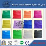 O poliéster 100% colorido Girar-Lig a tela não tecida para o saco de compra
