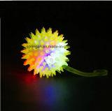 Plastikspielzeug mit greller Regenbogen-Kugel