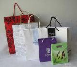 Sacs de papier de cadeau estampés par coutume bleue pour l'emballage de vêtement (FLP-8908)