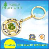 Regalo suave Keychain de oro del marco del metal del esmalte con la conexión del gancho de leva o del anillo